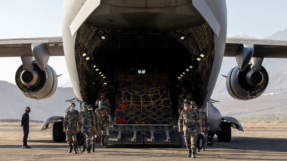 2020-09-15T14Indian soldiers disembark from a military transport plane at a forward airbase in Leh, in the Ladakh region, September 15, 2020. (Reuters)0349Z_1919732409_RC22ZI9CVCMM_RTRMADP_3_INDIA-CHINA
