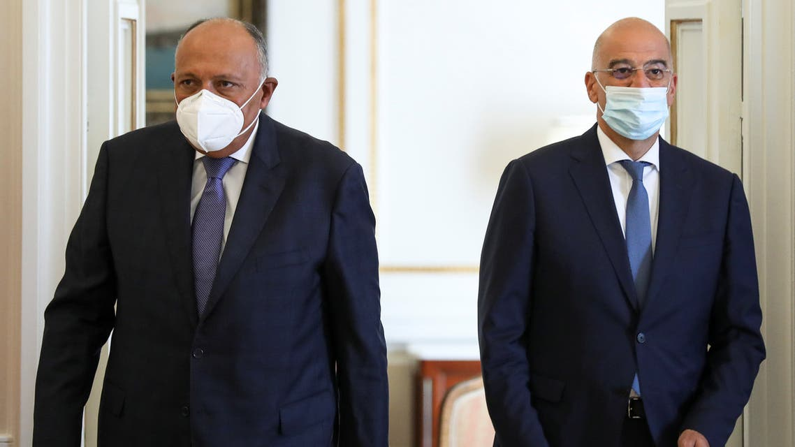 Greek Foreign Minister Nikos Dendias and his Egyptian counterpart Sameh Shoukry arrive to make a joint statement at the Foreign Ministry, in Athens, Greece September 15, 2020. REUTERS/Costas Baltas