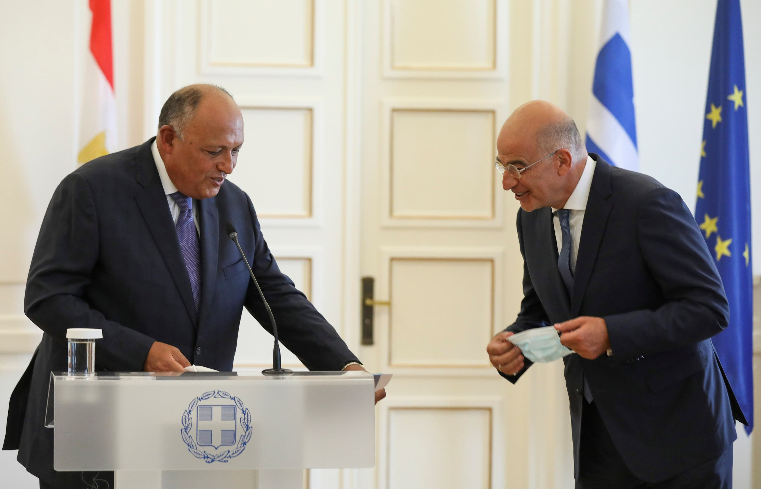 Greek Foreign Minister Nikos Dendias and his Egyptian counterpart Sameh Shoukry arrive to make a joint statement at the Foreign Ministry, in Athens, Greece September 15, 2020. (Reuters)