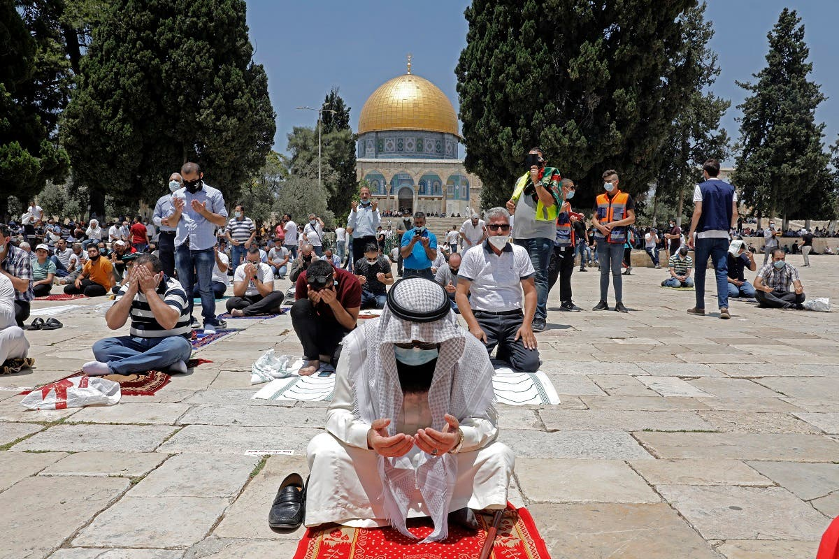 Palestinians perform the Friday prayer outside Jerusalem's Al-Aqsa mosque compound, Islam's third holiest site, amid the novel coronavirus pandemic crisis on July 10, 2020. (File photo: AFP)