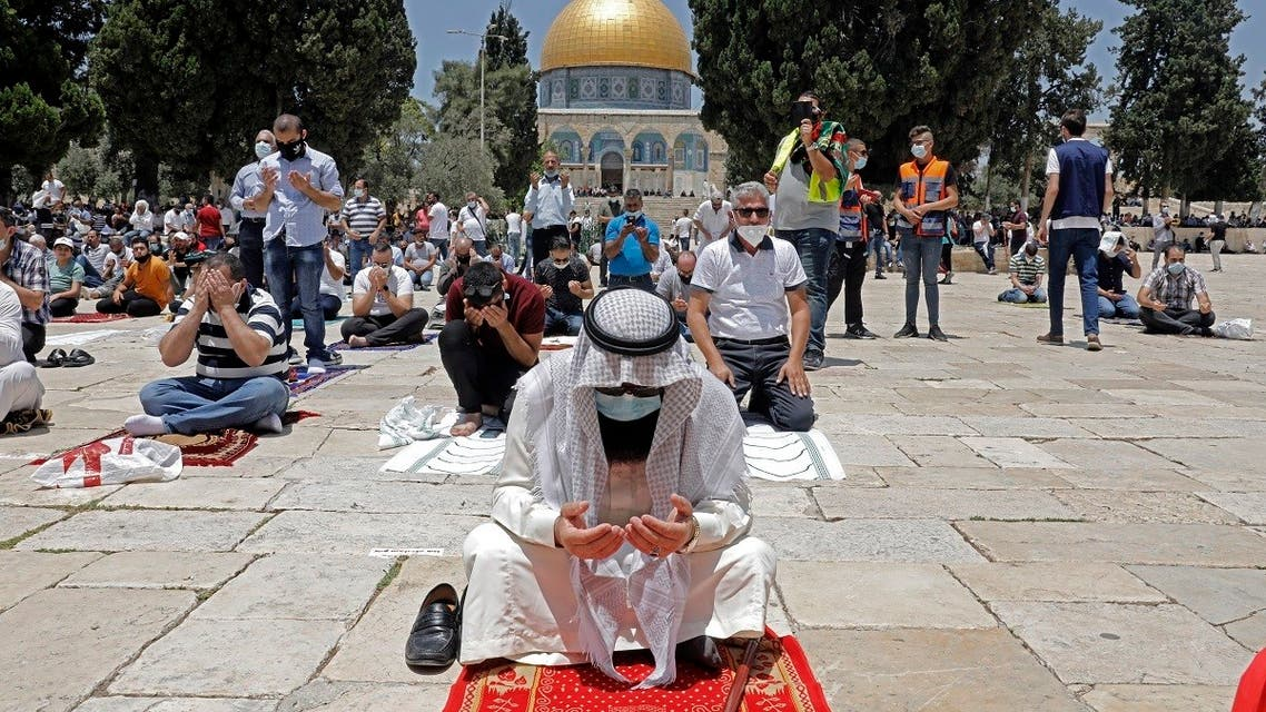 Palestinians perform the Friday prayer outside Jerusalem's Al-Aqsa mosque compound, Islam's third holiest site, amid the novel coronavirus pandemic crisis on July 10, 2020. (AFP)