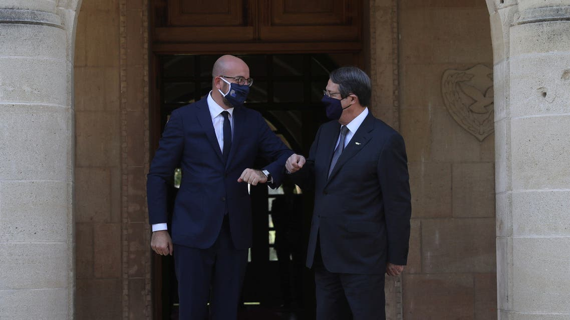 Cypriot President Nicos Anastasiades and European Council President Charles Michel bump elbows at the Presidential Palace in Nicosia, Cyprus September 16, 2020. REUTERS/Yiannis Kourtoglou
