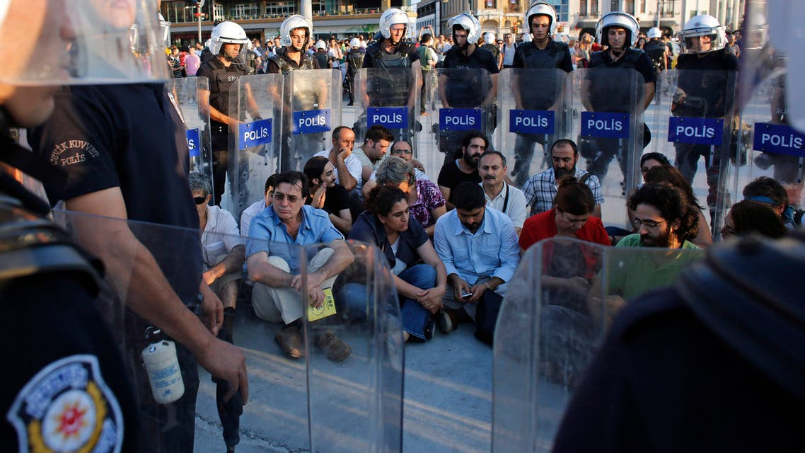 Pro-Kurdish Peace and Democracy Party (BDP) deputy Sebahat Tuncel (1st row, 3rd L) and her party members are surrounded by riot police as they hold a sit-in protest near Gezi Park in central Istanbul July 28, 2013. REUTERS/Murad Sezer (TURKEY - Tags: POLITICS CIVIL UNREST)