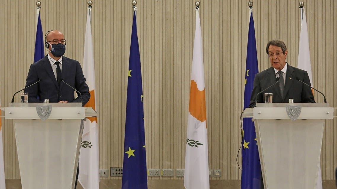 Cypriot President Nicos Anastasiades (R) and European Council President Charles Michel hold a joint press conference at the presidential palace in Nicosia on September 16, 2020. (AFP)