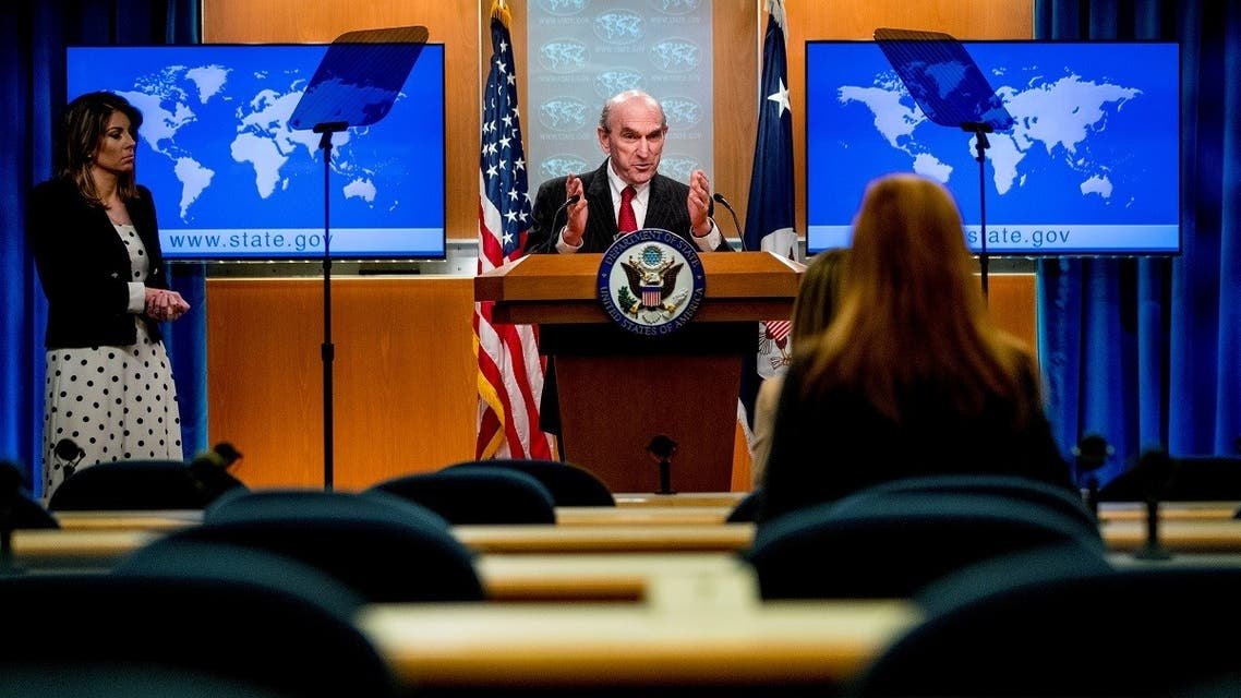 Elliott Abrams, accompanied by State Department spokeswoman Morgan Ortagus, speaks during a news conference at the State Department. (Reuters)