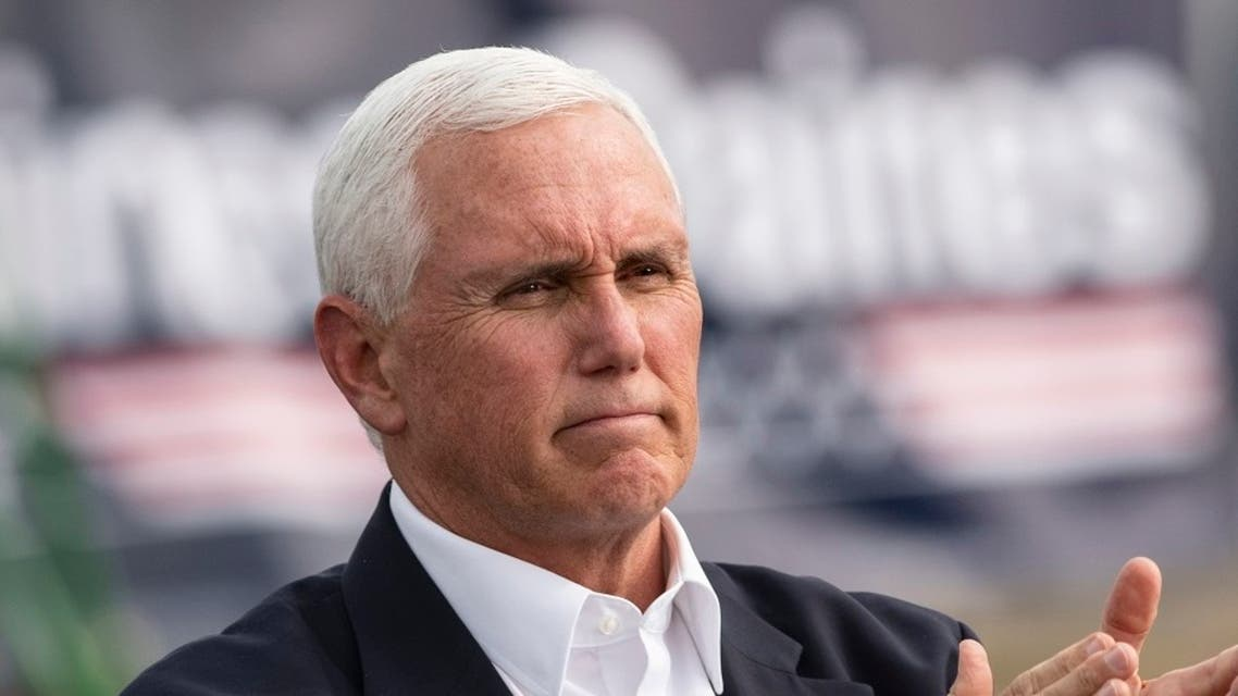 US VP Mike Pence claps at a Republican campaign rally in Belgrade, Montana, Sept. 14, 2020. (AP)