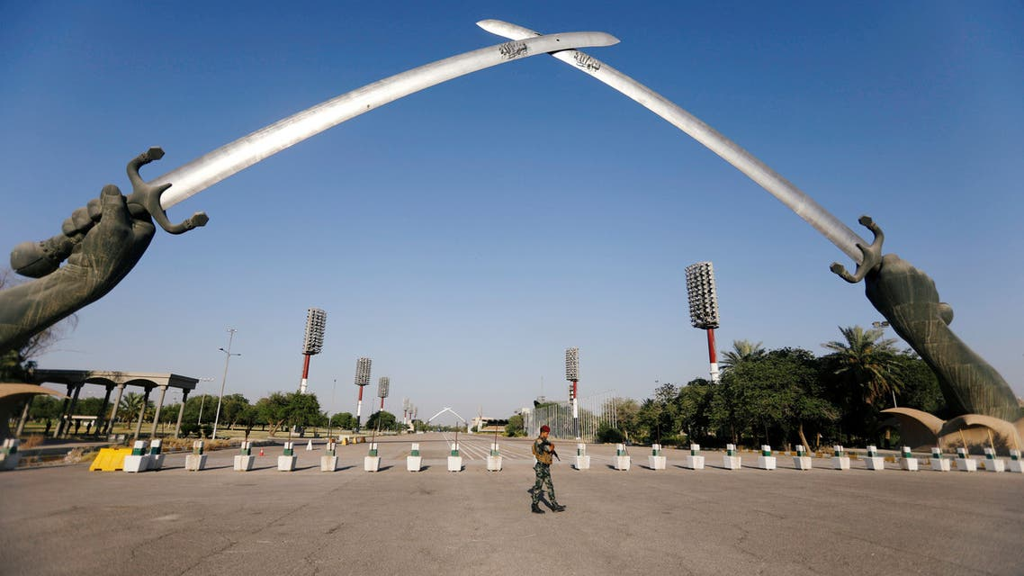 An Iraqi security officer walks near the Arch of Victory memorial in the Green Zone of Baghdad, Iraq June 24, 2019. Picture taken June 24, 2019. REUTERS/Khalid Al-Mousily