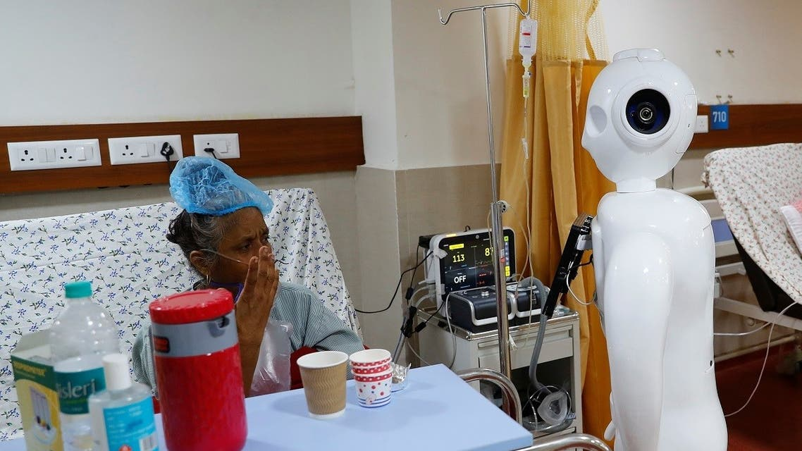 A patient suffering from the coronavirus disease speaks to his family members, using a robot named 'Mitra' at the ICUof the Yatharth Super Speciality Hospital in Noida, on the outskirts of New Delhi, India, on September 15, 2020. (Reuters)