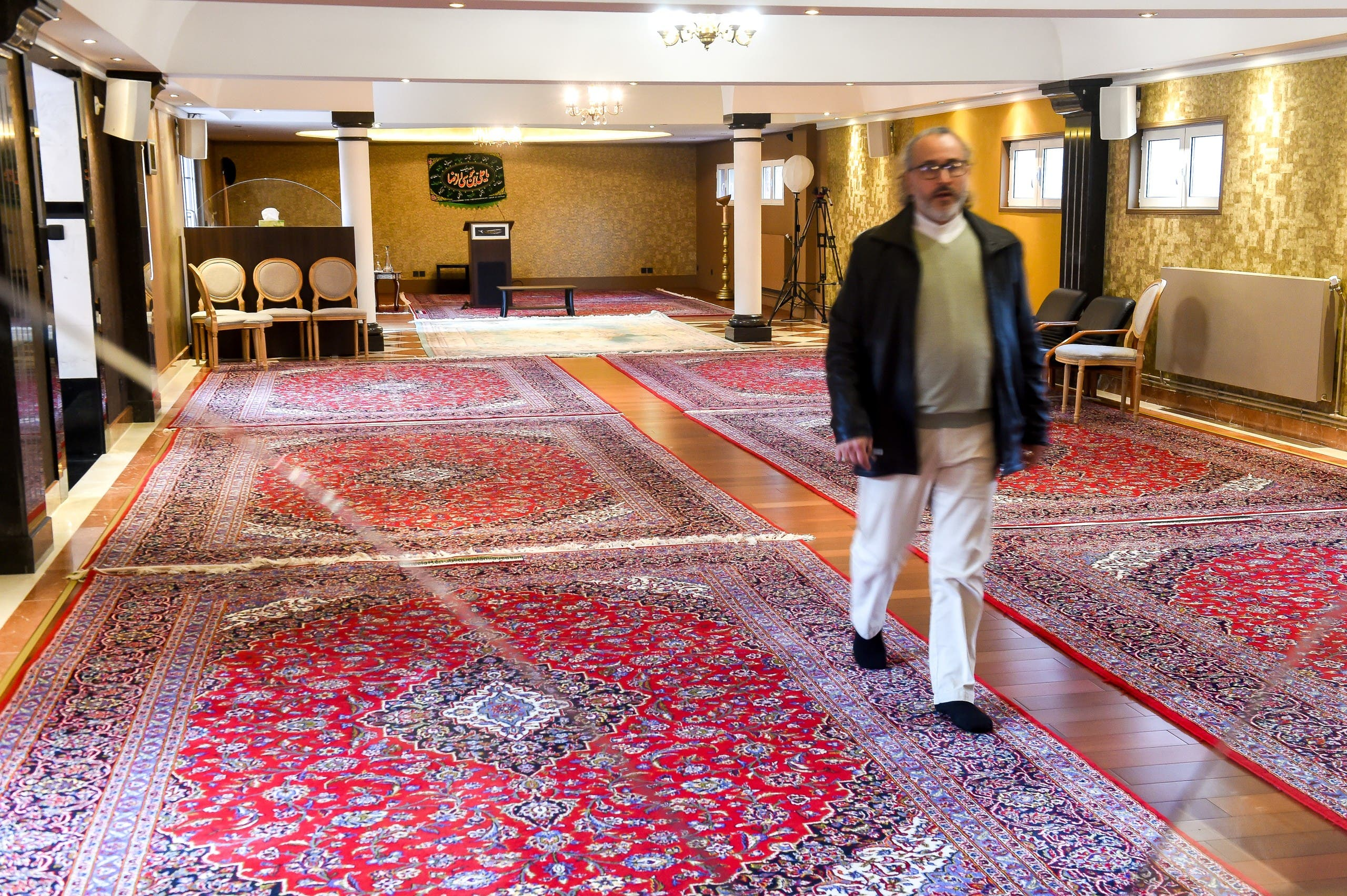 A man walks in the Zahra Centre in Grande Synthe, France. (AFP)