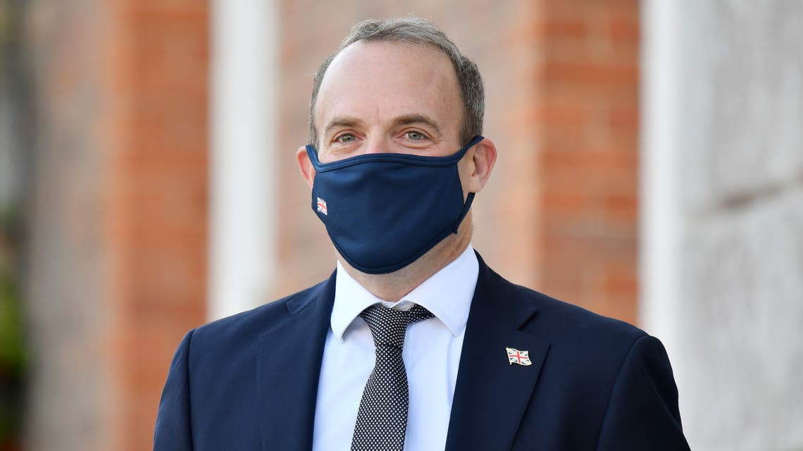 Britain's Foreign Secretary Dominic Raab wearing a protective face mask, waits to greet E3 foreign ministers at Chevening House, Sevenoaks, south of London, on September 10, 2020. The E3 foreign ministers met at the Foreign Secretary's country residence Chevening House.