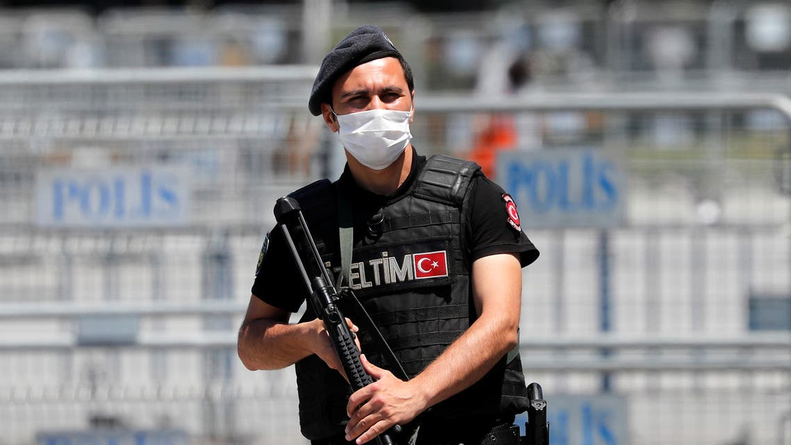 A Turkish riot police officer stands guard in front of the Justice Palace in Istanbul. (Reuters)