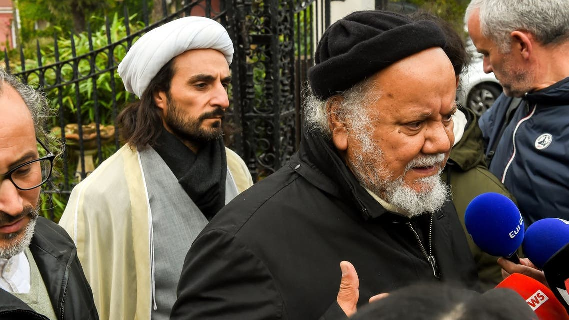 Founder of the Centre Zahra France religious association Gouasmi Yahia (R), flanked by Tahiri Jamel (L), head of the Centre, speaks to journalists, October 2, 2018. (AFP)