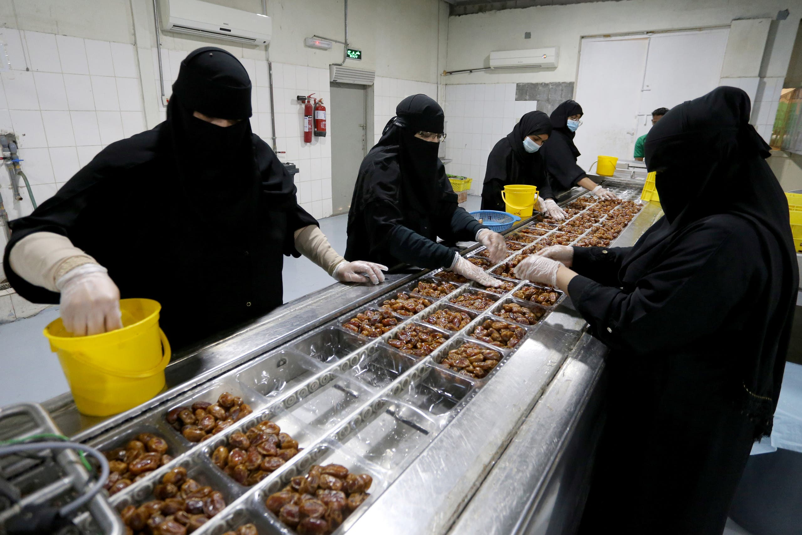 Saudi women work at a dates packaging factory in Al-Ahsa, Saudi Arabia. (Reuters)
