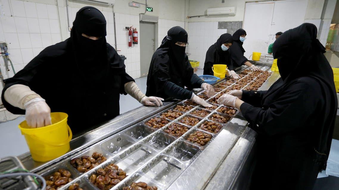 Saudi women work at a dates packaging factory in Al-Ahsa, Saudi Arabia. (Reuters)