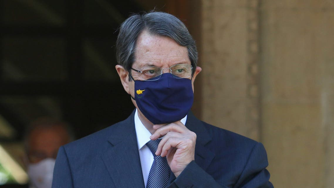 Cypriot President Nicos Anastasiades waits to welcome European Council President Charles Michel at the Presidential Palace in Nicosia. (Reuters)