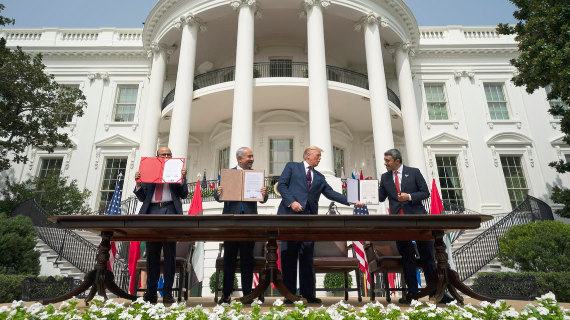 President Donald Trump, center, with from left, Bahrain Foreign Minister Khalid bin Ahmed Al Khalifa, Israeli Prime Minister Benjamin Netanyahu, and UAE Foreign Minister Abdullah bin Zayed al-Nahyan on the South Lawn of the White House, Tuesday, Sept. 15, 2020, in Washington. (AP)