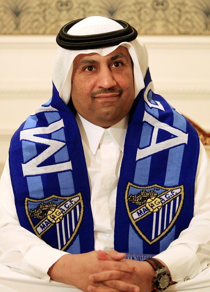 Sheikh Abdullah al Thani, new chairman of Spanish soccer club Malaga, wears a Malaga scarf during an interview in Doha December 9, 2010.  (Reuters)