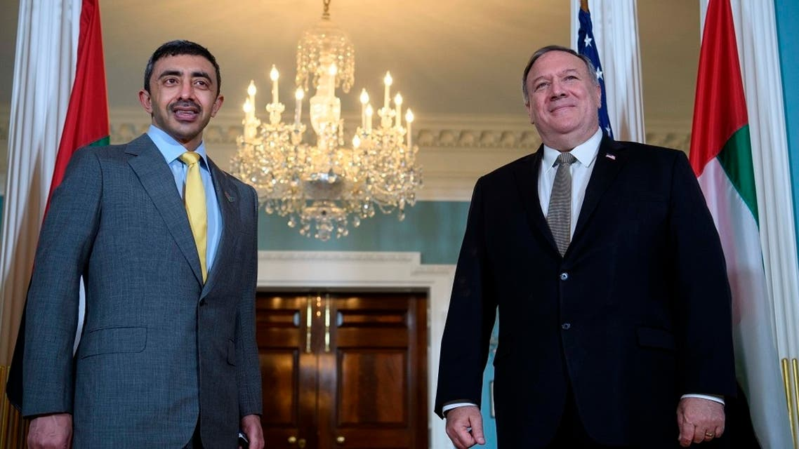 US Secretary of State Mike Pompeo stands with UAE FM Sheikh Abdullah bin Zayed al-Nahyan, at the State Department, Sept. 16, 2020. (AP)