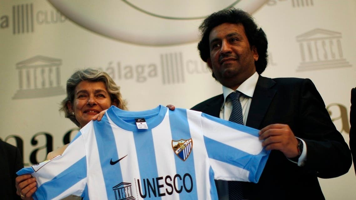 UNESCO Director-General Irina Bokova and Malaga FC's chairman Sheikh Abdullah Bin Nasser Al-Thani hold a Malaga team shirt during a news conference. (File photo: Reuters)