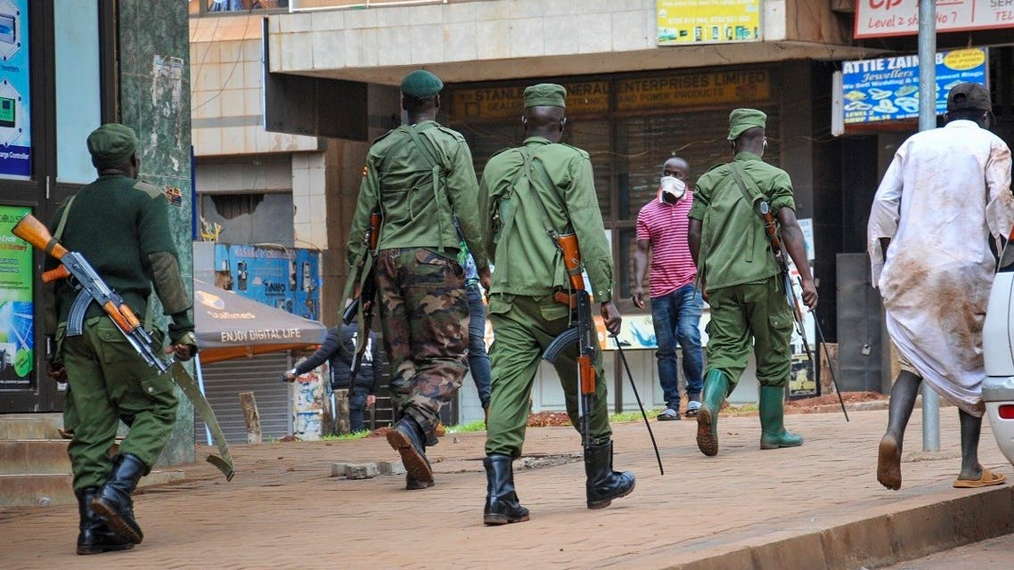 Ugandan police and other security forces chase people off the streets to avoid unrest, after police cleared a stand of motorcycle taxis which are no longer permitted to operate after all public transport was banned for two weeks to halt the spread of the new coronavirus, in Kampala, Uganda Thursday, March 26, 2020. (AP)