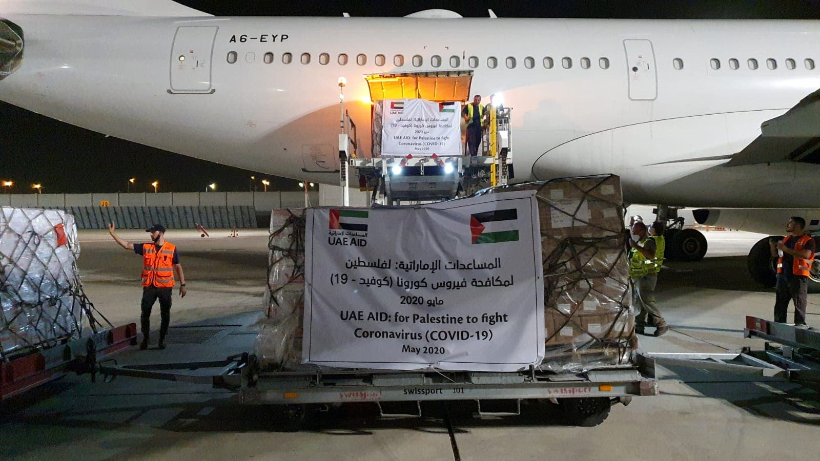A cargo plane operated by Abu Dhabi's Etihad Airways offloads aid related to the coronavirus disease (COVID-19) for Palestinians at Ben Gurion airport on May 19, 2020. (Reuters)