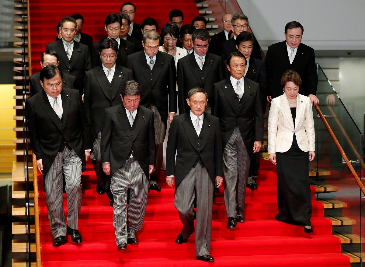 Japan's Prime Minister Yoshihide Suga (C) leads his cabinet ministers as they prepare for a photo session at Suga's official residence in Tokyo, Japan, September 16, 2020. (Reuters)