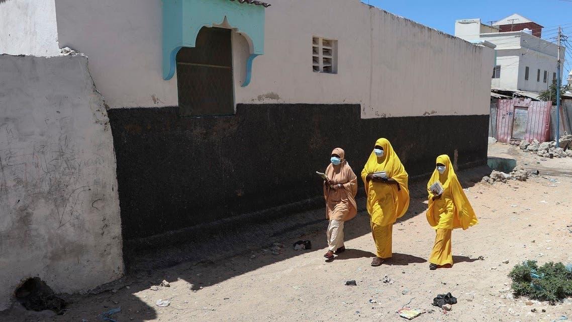 Students walk in a Mogadishu neighbourhood wearing face masks as protective measure against Coronavirus. (File photo: AFP)