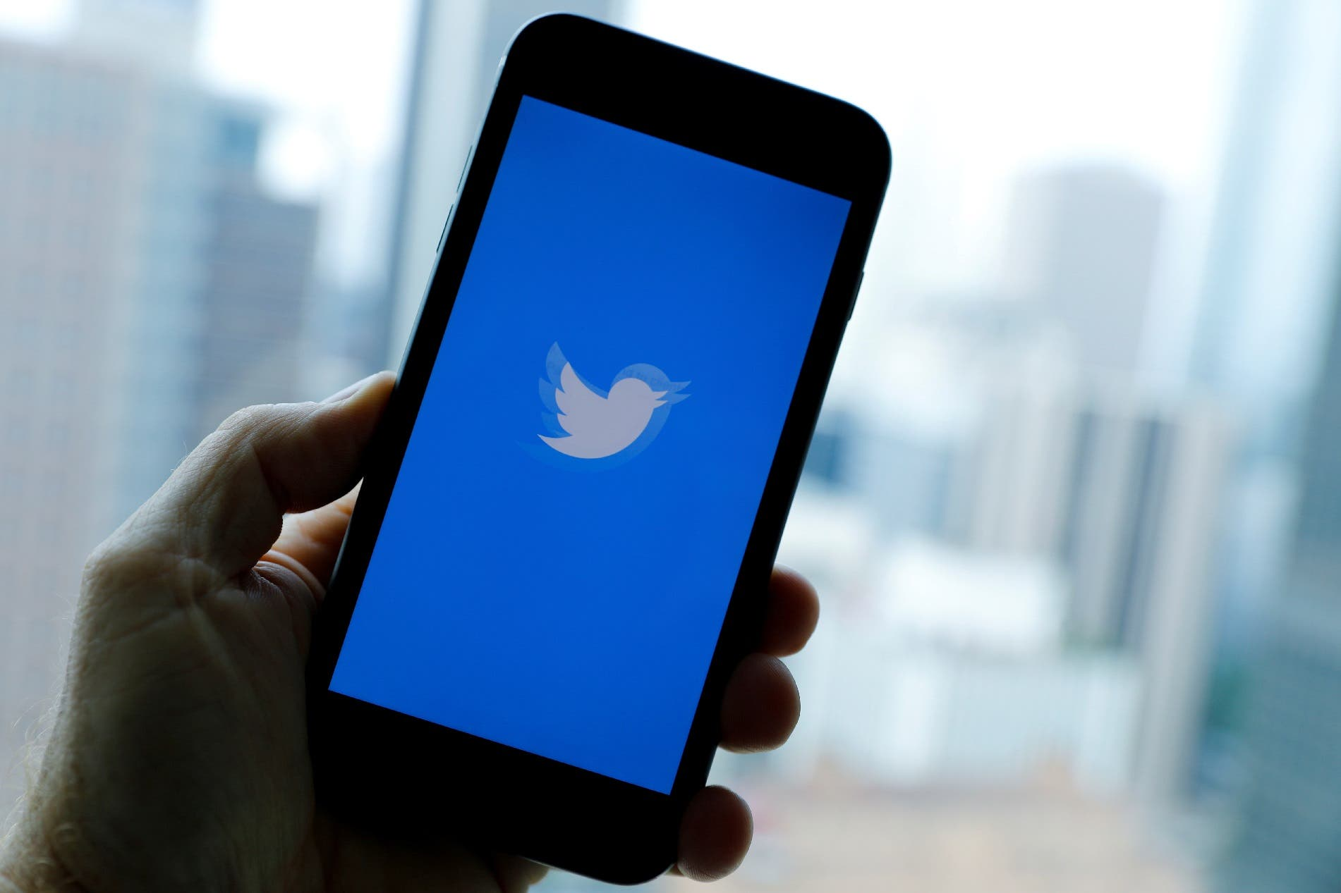 The Twitter logo is dispayed on a phone screen in an illustration. (File photo: Reuters)
