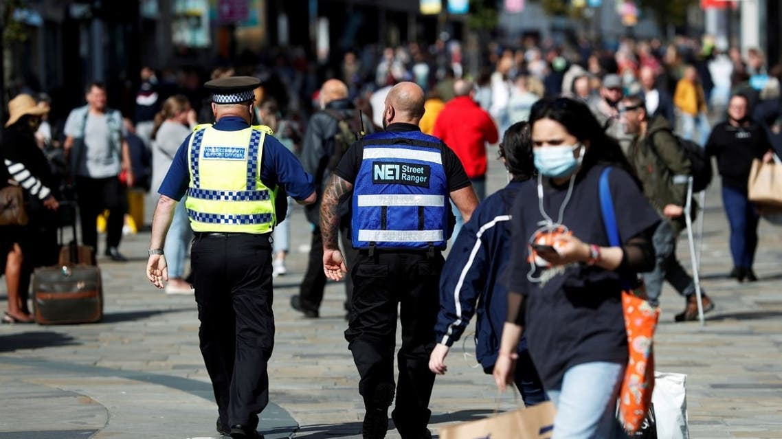 A street ranger and a police community support officer patrol Northumberland Street amid the spread of the coronavirus in Newcastle, Britain,  September 18, 2020. (Reuters)