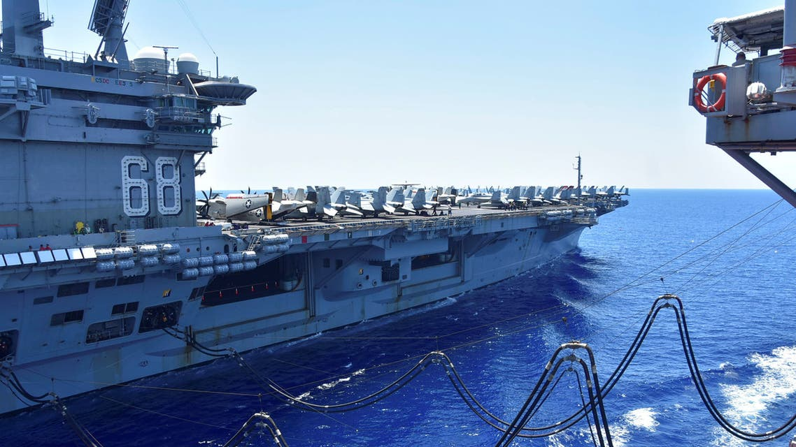 The U.S. Navy aircraft carrier USS Nimitz receives fuel from the Henry J. Kaiser-class fleet replenishment oiler USNS Tippecanoe during an underway replenishment in the South China Sea July 7, 2020. (Reuters)