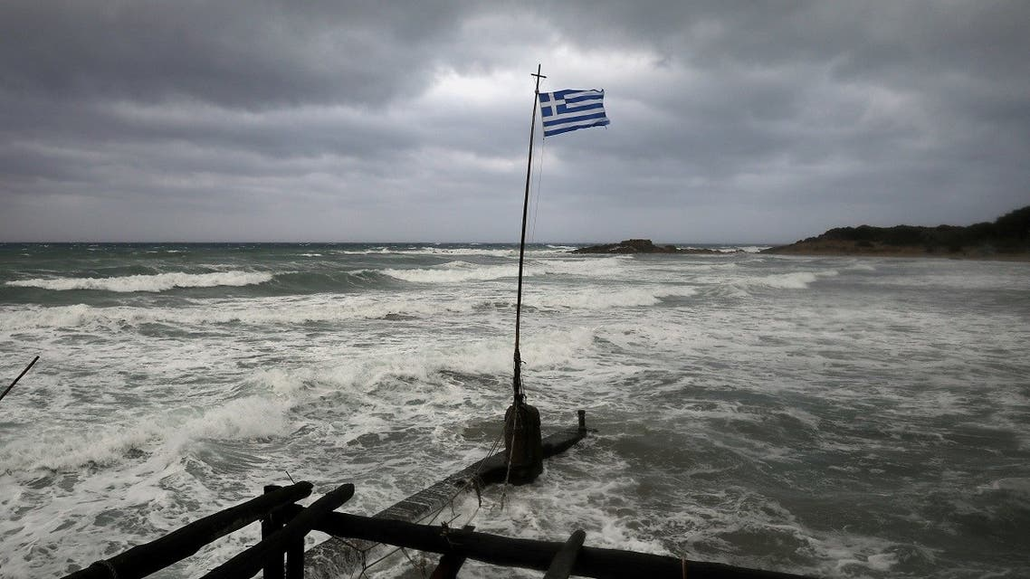 A Greek flag flatters in a beach near the town of Kyllini, as rare storm, known as a Medicane (Mediterranean hurricane), hit western Greece, September 18, 2020. (Reuters)