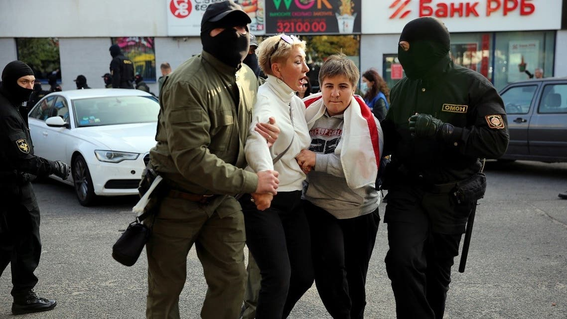 Law enforcement officers detain women during a rally to protest against the Belarus presidential election results in Minsk on September 19, 2020. (AFP)