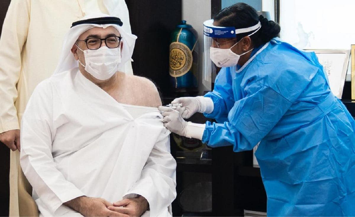 UAE's Minister of Health and Prevention Abdul Rahman al-Owais takes the first COVID-19 vaccine dose. (WAM)