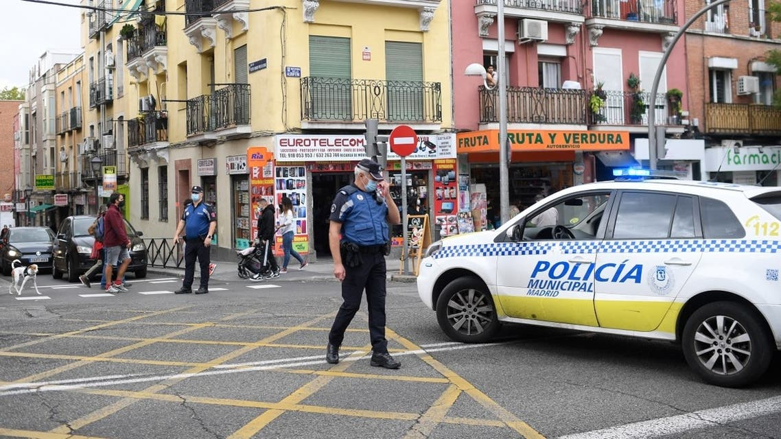 Policemen block a street at the Vallecas neighborhood in Madrid, on September 20, 2020, during a demonstration against the new restrictive measures announced by regional authorities. (AFP)