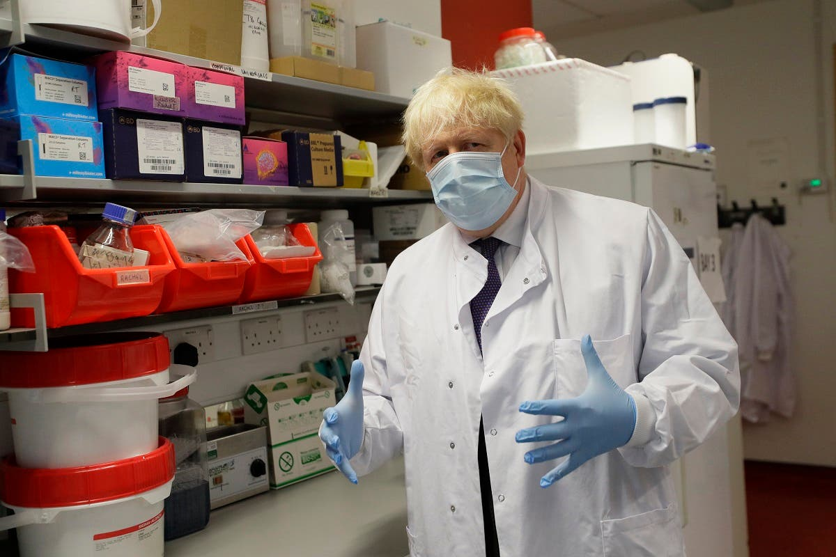 UK's PM Johnson during a visit to the Jenner Institute in Oxford, central England, on September 18, 2020, where he met scientists who are leading the covid-19 vaccine research. (AFP)