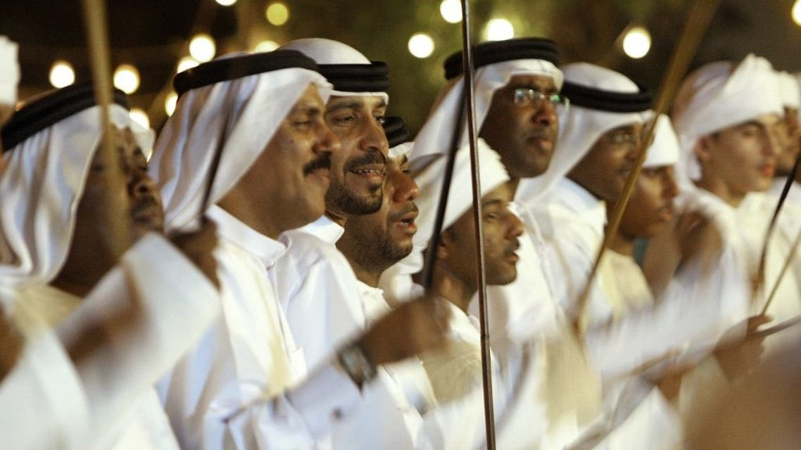 Emirati men dance during a mass wedding ceremony in the emirate of Umm al-Qaiwain on June 14, 2009. (File photo: AFP)