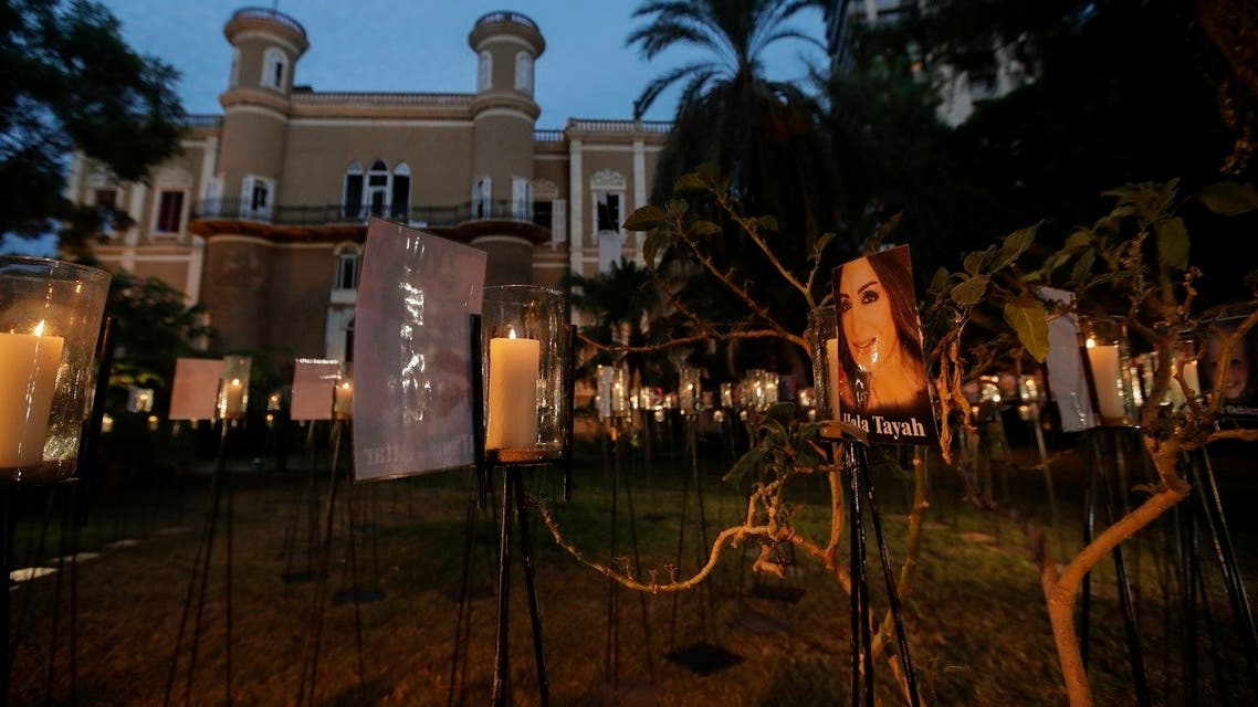 Candles light-up pictures of victims of August's deadly Beirut blast during a commemoration concert in the gardens of the damaged 19th-century Sursock Palace in Achrafieh. (AFP)