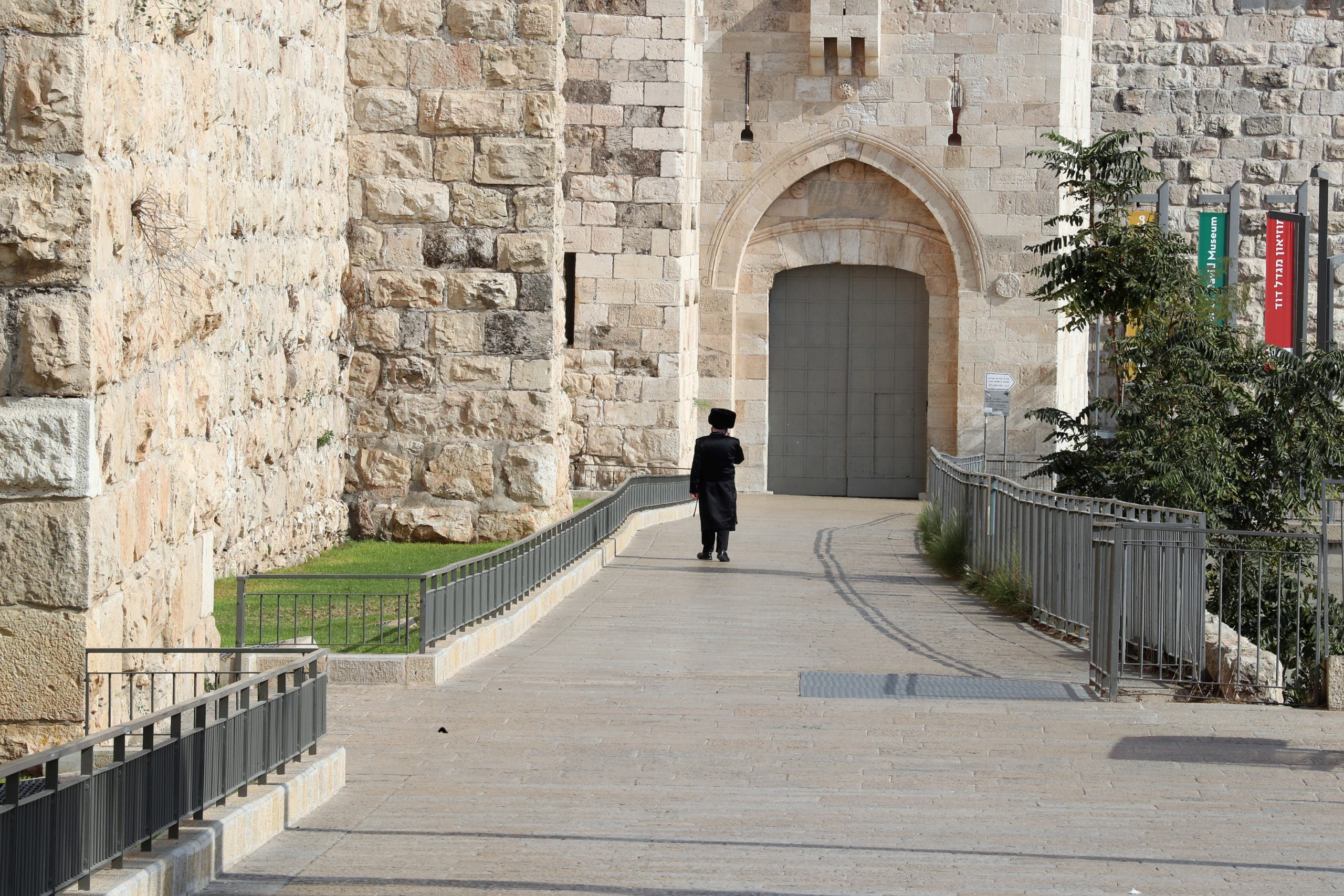 An ultra-Orthodox Jewish man walks outside Jerusalem's Old City after Israel entered a second nationwide lockdown amid a resurgence in the new coronavirus disease (COVID-19) cases on September 20, 2020. (Reuters)