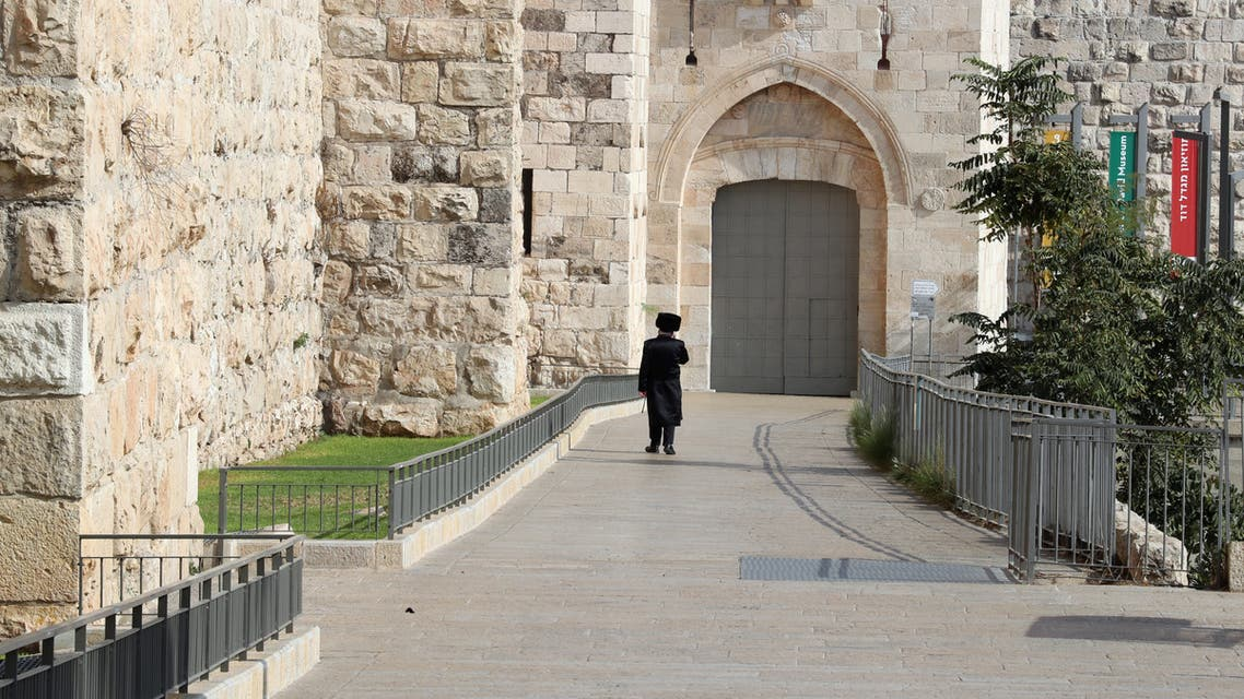 An ultra-Orthodox Jewish man walks outside Jerusalem's Old City after Israel entered a second nationwide lockdown amid a resurgence in the new coronavirus disease (COVID-19) cases on September 20, 2020. (AP)