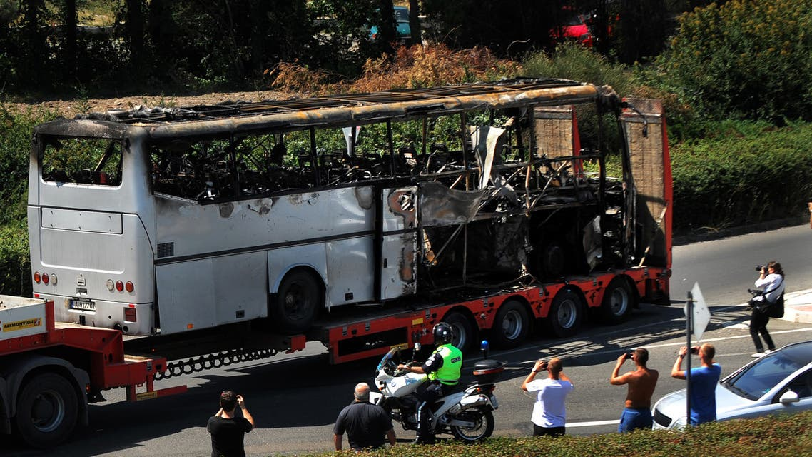 A truck carries the bus damaged by the suicide bomb blast which targeted a group of Israeli tourists at the airport in Bourgas, Bulgaria, on July 19, 2012. (AFP)