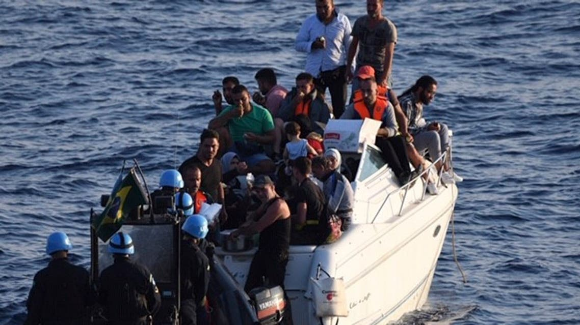 A boat overcrowded with migrants in the Mediterranean Sea. The UN peacekeeping force in Lebanon says the migrants were trying to reach the Mediterranean island of Cyprus. (File photo: AP)