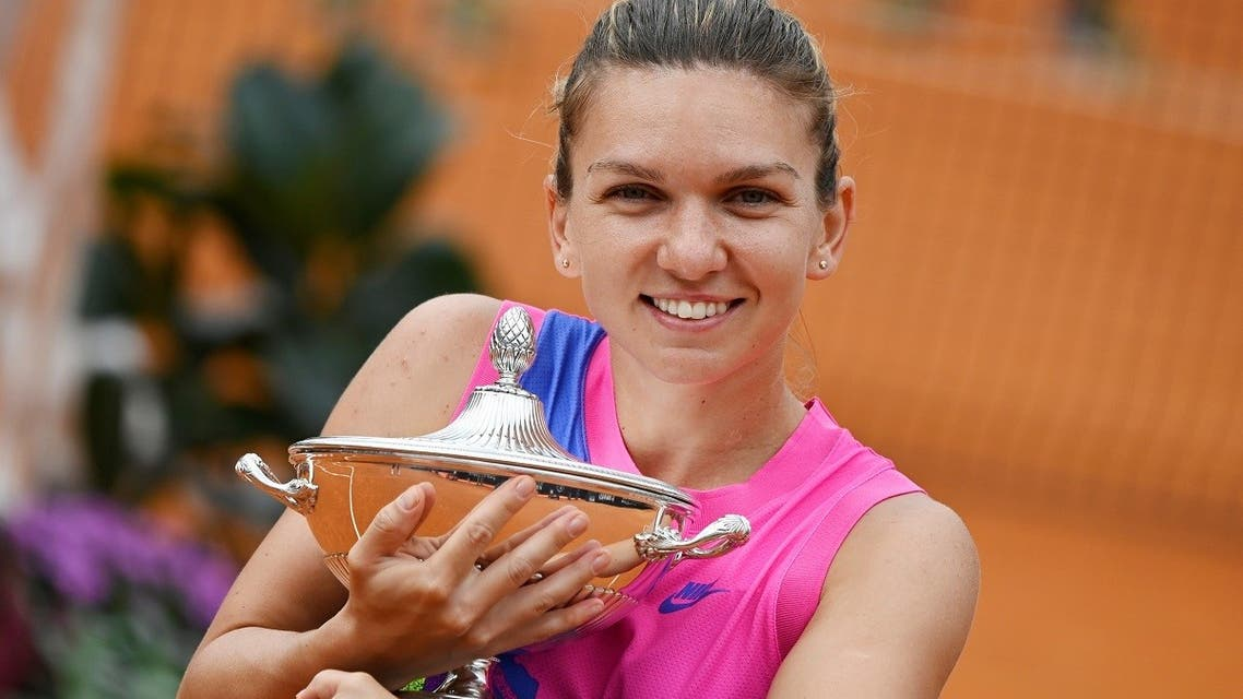 Romania's Simona Halep  the trophy after Czech Republic's Karolina Pliskova retired from the match at the Italian Open in Rome, on September 21, 2020. (Reuters)