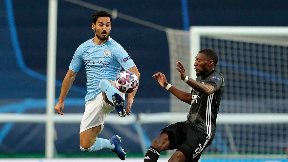 Manchester City's Ilkay Gundogan kicks the ball clear during the Champions League quarterfinal soccer match between Lyon and Manchester City at the Jose Alvalade stadium in Lisbon, Portugal, Saturday, Aug. 15, 2020. (Miguel A. Lopes/Pool via AP)