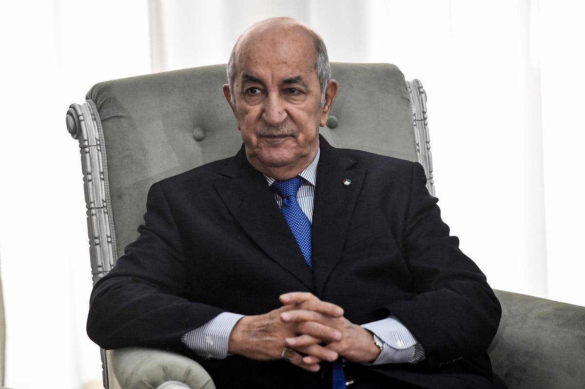 Algerian President Abdelmadjid Tebboune meets with the visiting French Foreign Minister (unseen) in the capital Algiers on January 21, 2020. (AFP)