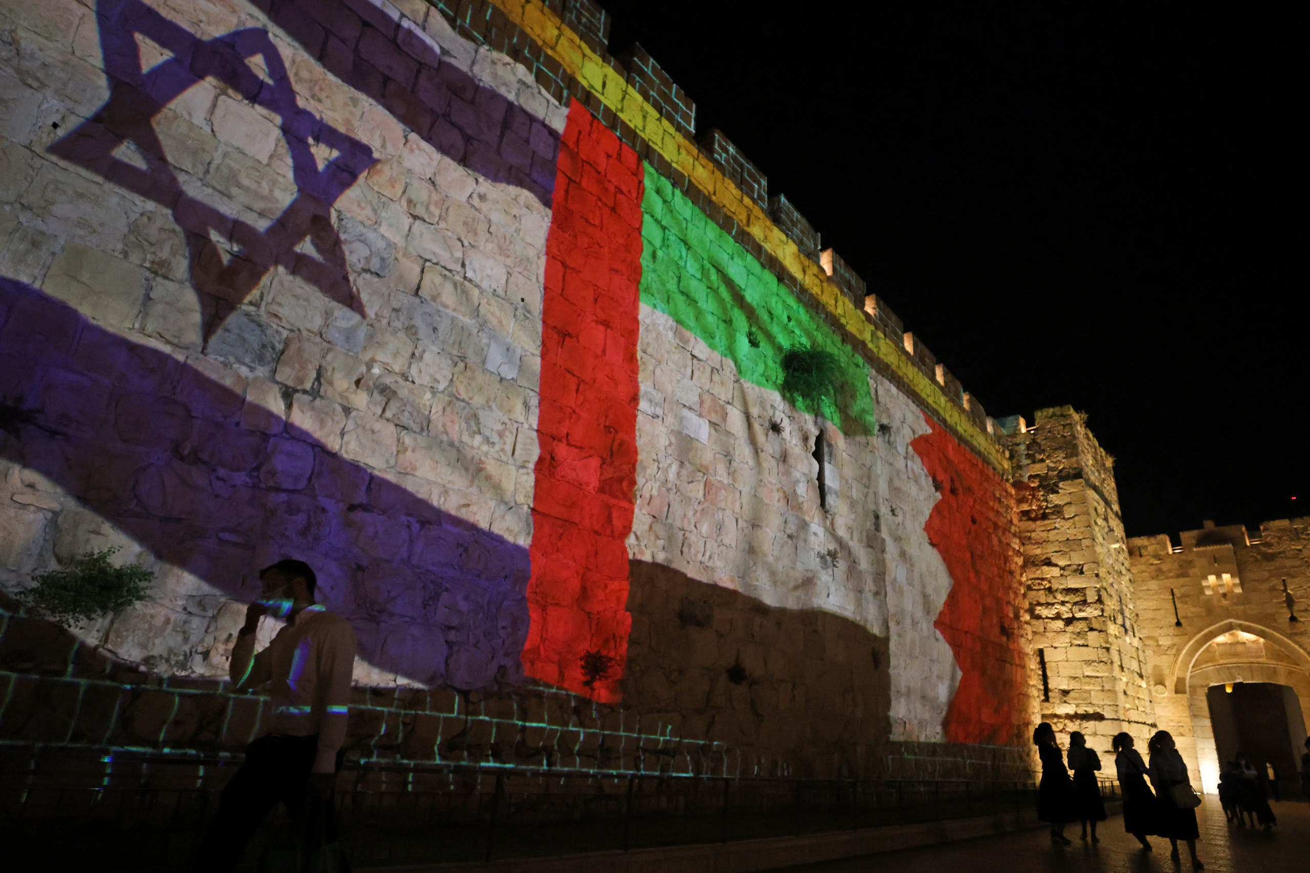 The flags of Israel, United Arab Emirates, and Bahrain are projected on the ramparts of Jerusalem's Old City on September 15, 2020. (AFP)