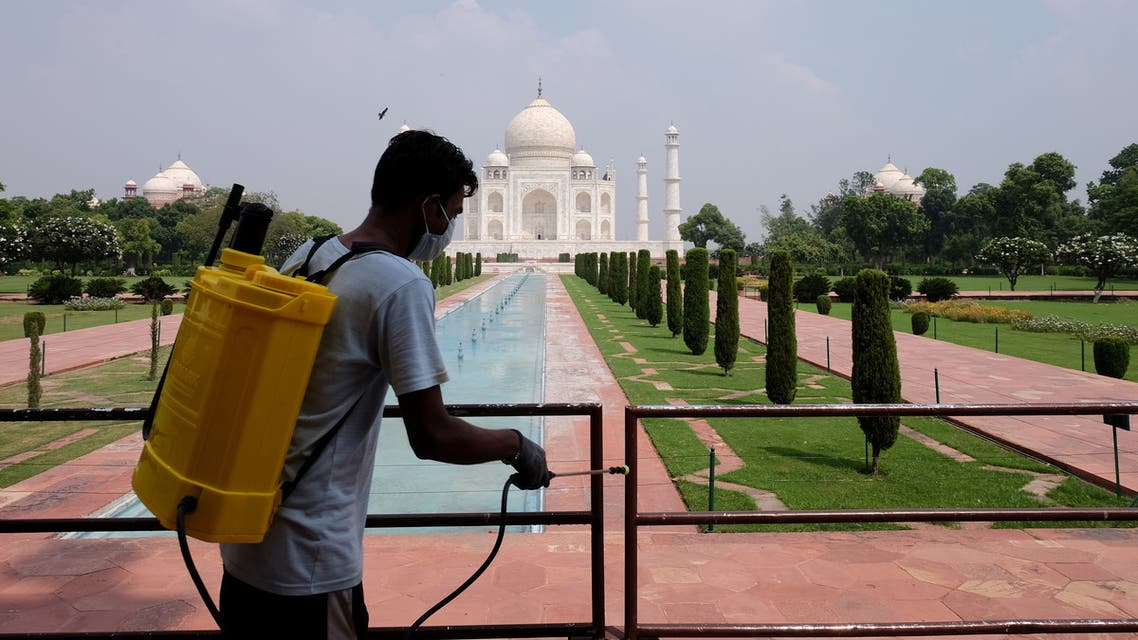 A man sanitizes railings in the premises of Taj Mahal after authorities reopened the monument to visitors, amidst the coronavirus disease (COVID-19) outbreak, in Agra, India. (Reuters)