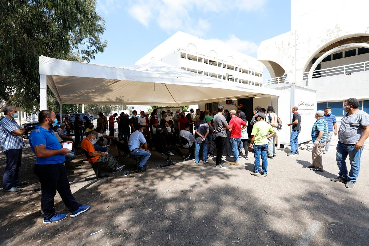 People wait for PCR tests Beirut Rafik Hariri University Hospital on August 25, 2020. (AFP)