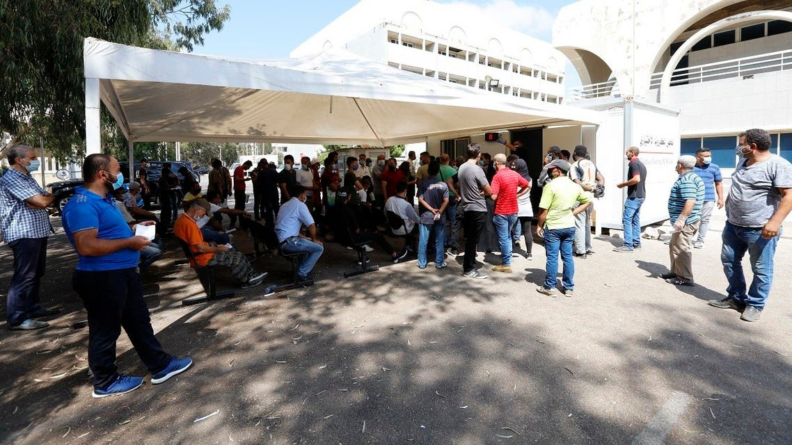People wait for PCR tests Beirut Rafik Hariri University Hospital on August 25, 2020. (AFP)