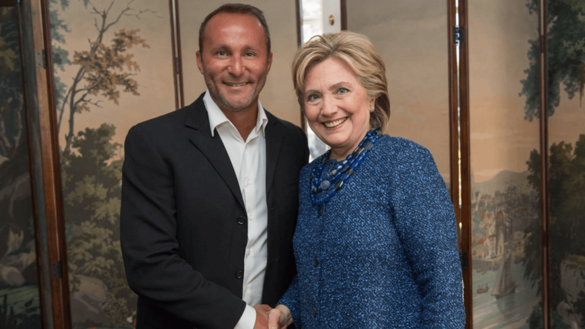 Allid Wallet CEO Andy Khawaja meets with Hilary Clinton, in Los Angeles, in 2016. (Allied Wallet website)