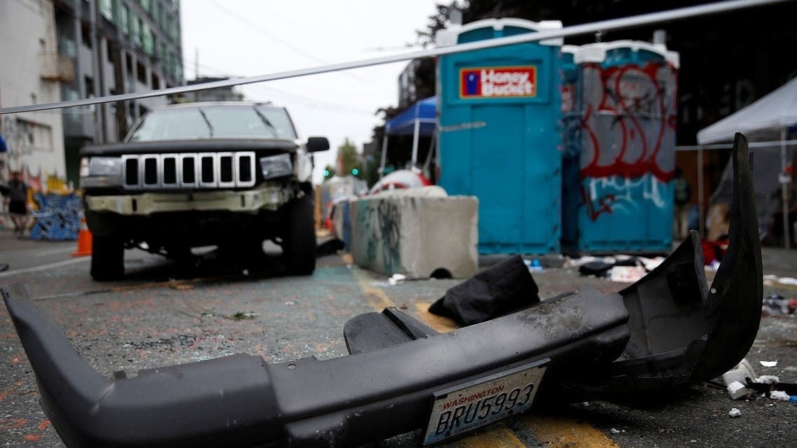 A car with several broken windows and a broken bumper sits at the CHOP (Capitol Hill Organized Protest) n Seattle, Washington, June 29, 2020. (Reuters)